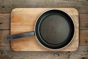 Frying pan on chopping board