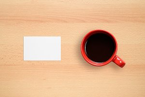 Business card and coffee cup