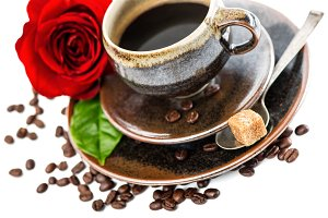 Black coffee and red rose flower