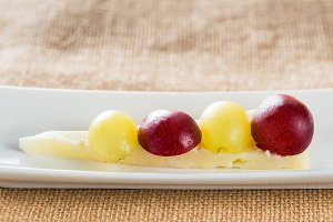 Cheese snack and grapes