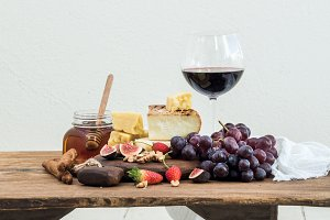 Glass of red wine & cheese board