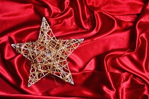 Christmas tree star on red satin