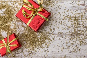 Holiday gifts in red and gold