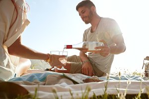 Young couple enjoying a picnic with