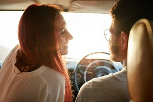 Smiling couple enjoying on the road