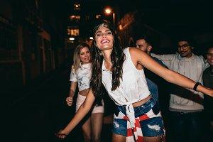 Beautiful young woman dancing in par