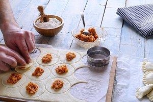 Man's hands making dumplings