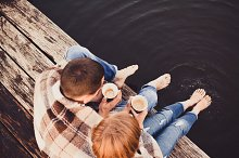 Young Couple on Warm Old Pier