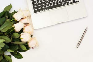 Working place with laptop and roses