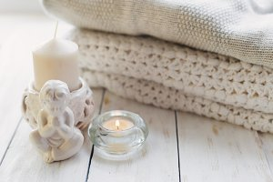 cozy knitted sweaters and candle