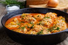 meatballs in a pan on rustic