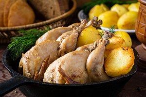 Roasted quails and potatoes