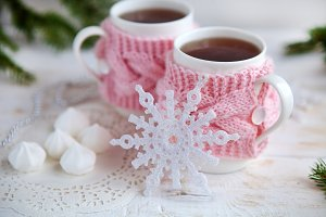 cup of hot tea in knitted cup holder