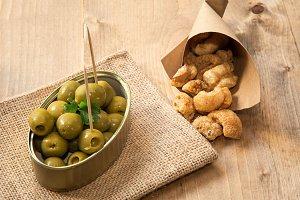 Beer cap and olives pork rinds