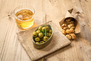 Beer cap and olives pork rinds