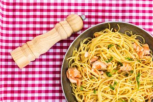 Noodles with salmon and parsley in p