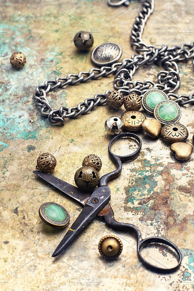 Metal beads,buttons,chain and scisso - Industrial