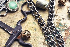 Metal beads,buttons,chain and scisso