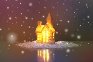 festive light in house with snow