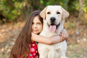 A beautiful girl and labrador retriever