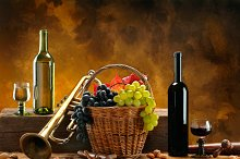pipe bottles and glasses of wine and grapes.jpg