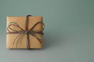 Gift box with purple and gray ribbon