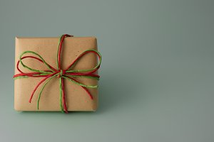 Gift box with red and green ribbon