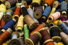 Colored sewing threads background