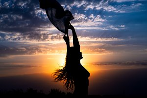 Girl silhouette on beautiful sunset