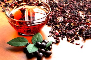 Cup of black tea with mint leaves