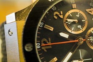 Gold watch macro background