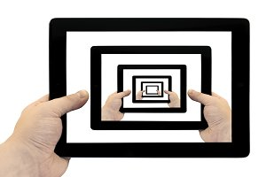Tablet PC in hand looped on screen