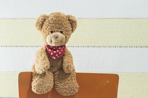 Teddy bear in a baby room