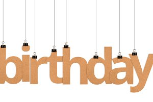 birthday word hanging on strings