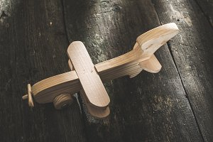 Vintage wooden plane on wooden board