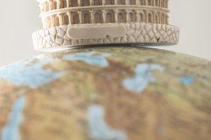 Coliseum of Rome on globe