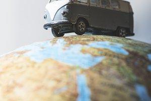 Vintage VW bus on globe
