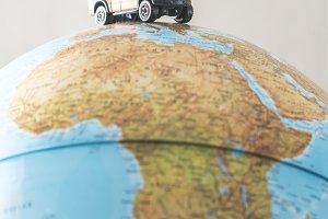 Offroad car on globe