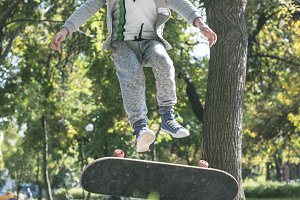 Boy with skateboard in the park