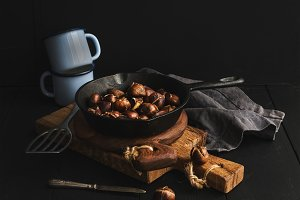 Roasted chestnuts in cooking pan