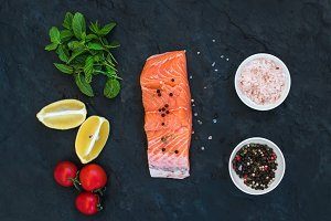 Salmon filet, lemon, cherry tomatoes