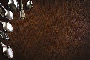 Silver spoons in corner