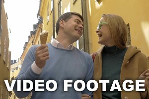 Happy man and woman eating ice-cream