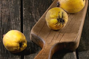 Quinces over wood