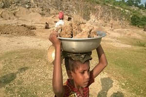 A child is collecting stone