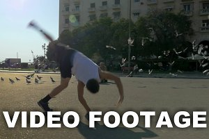 Teenager doing acrobatics on city