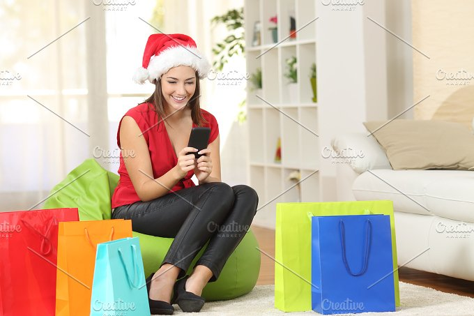 Girl texting greeting sms on mobile phone.jpg - Technology