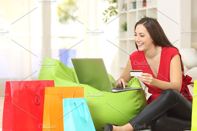 Lady buying online with a credit card.jpg - Technology