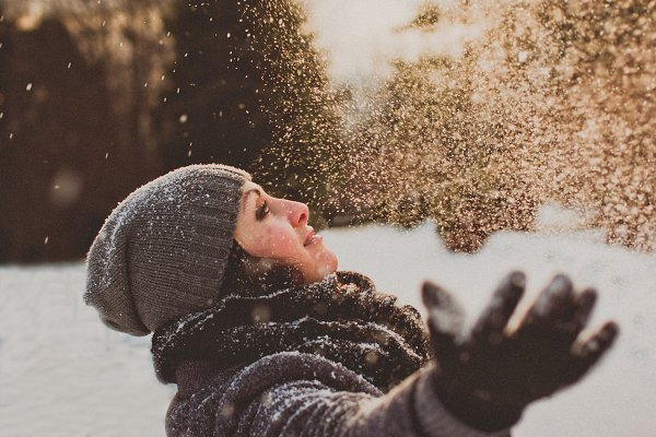 Girl Playing with Snow in the Park