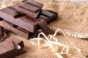 Heap portions chocolate on burlap